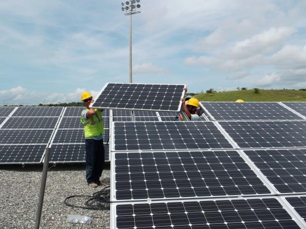 Solar Source - Orange County Convention Center - Orlando, FL 1 MW - worker installing